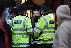 © under license to London News Pictures. 29/01/2011. A young man is detained by police during more student demonstrations today (29/01/2011). Thousands of students took to the streets of London and Manchester to protest against cuts to education. Photo credit should read: London News Pictures