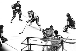 Seals Billy Hicke ready to shoot on Vancouver goalie Dunc Wilson, Gary Jarrett #12, and #5John Schella.<br />(1971 photo/Ron Riesterer)