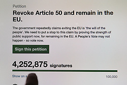 March 23, 2019 - London, United Kingdom - A person points at the figure on the UK Government's Petition website where over four million people have signed the ''Revoking Article 50 Petition'' calling for British Prime Minister Theresa May to cancel Brexit by revoking Article 50. (Credit Image: © Dinendra Haria/SOPA Images via ZUMA Wire)