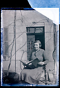 female person posing with a book France 1934