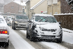 © Licensed to London News Pictures.27/02/2018<br /> Borough Green, UK.<br /> Heavy snow fall in Borough Green in Kent as cars travel very slow in the snow on the A25.<br /> Photo credit: Grant Falvey/LNP