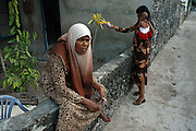 Huraa island was badly hit by the tsunami. Evacuated women and children begin to return home and try to begin rebuilding their homes. Their livelihoods, dependent on tourism, are seriously threatened.<br /> <br /> Maldives,  3 Jan 2005<br /> <br /> ฉJeremy Horner/Unicef
