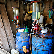 Hand-cranked gas pumps at a roadside market in Luang Namtha province in northern Laos.