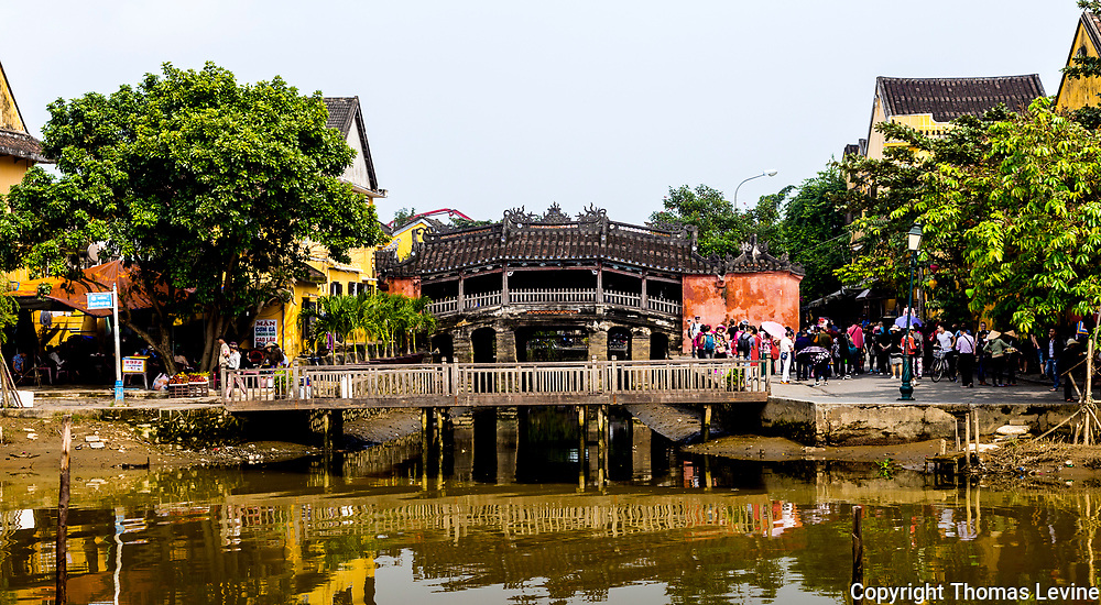 Dec., 2017, Hoi An: Daytime at the Japanese Covered Bridge with tourists groups. RAW to Jpg