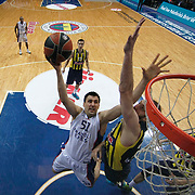Anadolu Efes's Milko Bjelica (C) during their Turkish Airlines Euroleague Basketball Top 16 Round 14 match Fenerbahce Ulker between Anadolu Efes at the Ulker Sports Arena in Istanbul, Turkey, Thursday 09 April, 2015. Photo by Aykut AKICI/TURKPIX