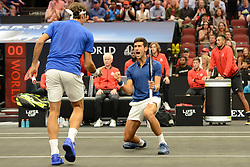 September 21, 2018 - Chicago, Illinois, U.S. - NOVAK DJOKOVIC celebrates with ROGER FEDERER during doubles action at the 2018 Laver Cup tennis event in Chicago. (Credit Image: © Christopher Levy/ZUMA Wire)