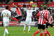 Swansea's Alberto Paloschi (c) looks to control a high ball. Barclays Premier league match, Swansea city v Southampton at the Liberty Stadium in Swansea, South Wales on Saturday 13th February 2016.<br /> pic by  Carl Robertson, Andrew Orchard sports photography.