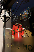A formal military dress uniform of a guardsman on display in a london's taylor's premises in Sackville Street, London. Jones Chalk & Dawson have well over a century of fine tailoring tradition. The company commenced trading in 1896 when William Jones broke away from Hawkes of Savile Row (later Gieves and Hawkes), where he was head military cutter. Joseph H Dawson and Arthur Chalk also worked at Hawkes. In 1902 the young company were soon a Royal appointment from HRH the Prince of Wales, later King George V. In 1940 they were appointed by King George VI and today, Jones Chalk & Dawson continue to hold a warrant to the Belgian Royal Family.