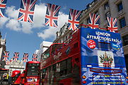 The rear of a London tour bus featuring an illustration of tourist attractions, with an iVenture card saves visitors up to 50% on tickets at the capitals landmarks, on 1st May, in Piccadilly Circus, London, England.