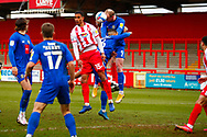 Terence Vancooten of Stevenage jumps to header the ball during the EFL Sky Bet League 2 match between Stevenage and Harrogate Town at the Lamex Stadium, Stevenage, England on 6 March 2021.