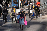 With local coronavirus lockdown measures in place and Birmingham currently set at 'Tier 2' or 'high', people, many of whom are wearing face masks, come shopping in the city centre on 26th October 2020 in Birmingham, United Kingdom. The three tier system in the UK has levels: 'medium', which includes the rule of six, 'high', which will cover most areas under current restrictions; and 'very high' for those areas with particularly high case numbers. Meanwhile there have been calls by politicians for a 'circuit breaker' complete lockdown to be announced to help the growing spread of the Covid-19 virus.