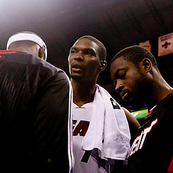 October 13, 2010; New Orleans, LA, USA; Miami Heat power forward Chris Bosh (1) talks with teammates small forward LeBron James (6) and shooting guard Dwyane Wade (3) during a time out during a game against the New Orleans Hornets at the New Orleans Arena. The Hornets defeated the Heat 90-76. Mandatory Credit: Derick E. Hingle