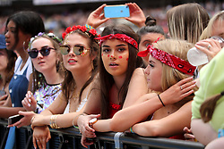 Fans during Capital's Summertime Ball. The world's biggest stars perform live for 80,000 Capital listeners at Wembley Stadium at the UK's biggest summer party.