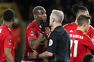 Manchester United Midfielder Paul Pogba argues with Referee Martin Atkinson during the The FA Cup match between Wolverhampton Wanderers and Manchester United at Molineux, Wolverhampton, England on 16 March 2019.