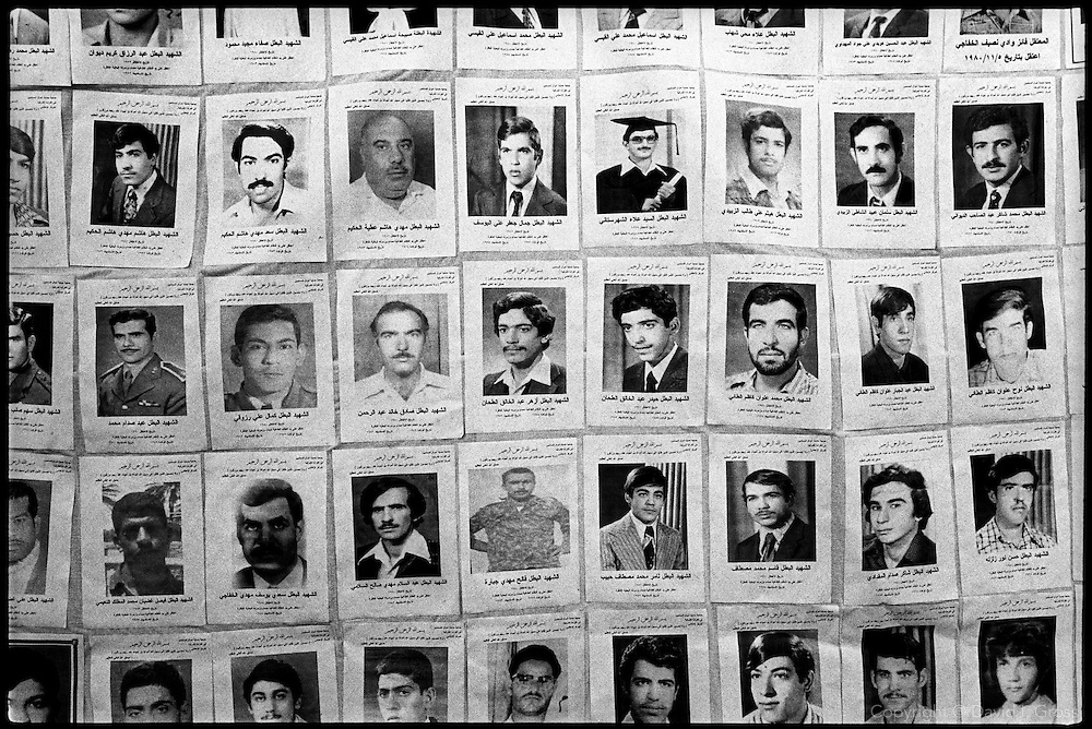A universal expression of personal misfortune: pictures and names of missing men in a street display of faces of those taken away by Saddam Hussein's regime in the 1980's and 1990's.