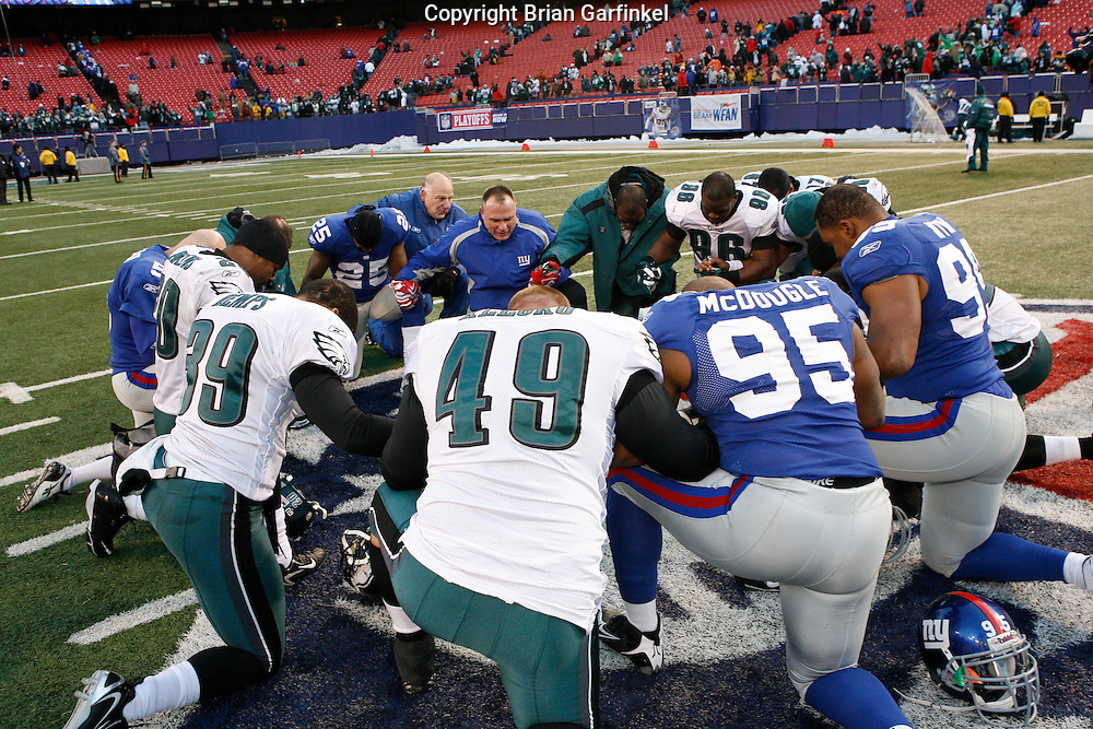 11 Jan 2009: Philadelphia Eagles and New York Giants come together after the game to pray on January 11th, 2009.  The  Eagles won 23-11 at Giants Stadium in East Rutherford, New Jersey.