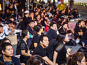 05 NOVEMBER 2016 - BANGKOK, THAILAND:  A crowd of mourners wait for members of the Thai Royal Family to leave the Palace at the end of the day. Mourners continue to go to the palace to honor the King, Bhumibol Adulyadej, nearly three weeks after his death.    PHOTO BY JACK KURTZ