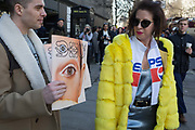 Free magazines featuring a models eye on the cover are being handed out on the first day of London Fashion Week, in the Strand, on 16th february 2018, in London, England.