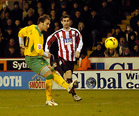 Photo: Jed Wee.<br />Sheffield United v Norwich City. Coca Cola Championship.<br />26/12/2005.<br />Norwich's Dean Ashton (L) hooks a shot towards goal in the build up to their third goal.