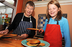 A granny bakes biscuits with her grandaughter. MODEL RELEASED