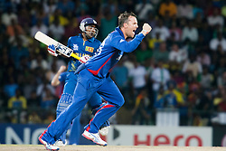 © Licensed to London News Pictures. 01/10/2012. Englishmen Graeme Swann celebrates after getting the wicket of Mahela Jayawardene during the T20 Cricket World super 8's match between England Vs Sri Lanka at the Pallekele International Stadium Cricket Stadium, Pallekele. Photo credit : Asanka Brendon Ratnayake/LNP
