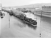 9969-7240. Portland flood, with switching trains operating near the Burnside Bridge. May 30, 1948.