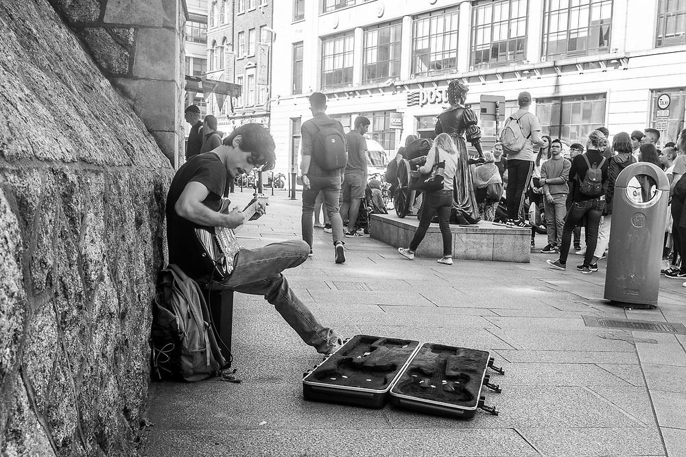 Busker performing in Dublin, Ireland.