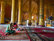 10 NOVEMBER 2014 - SITTWE, MYANMAR:  A girl prays in Lokananda Paya, the main Buddhist pagoda (paya) in Sittwe, Myanmar. The pagoda was dedicated in 1997. Sittwe is a small town in the Myanmar state of Rakhine, on the Bay of Bengal.   PHOTO BY JACK KURTZ
