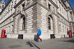 © Licensed to London News Pictures. <br /> London, UK. 24/03/2020. A man wearing a face mask walks in Westminster, central London as after the Prime Minister Boris Johnson announced the first coronavirus lockdown yesterday.<br /> Photo credit: Marcin Nowak/LNP