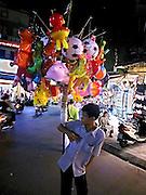Vietnam, Hanoi: street seller...Vietnam, Hanoi: street seller...
