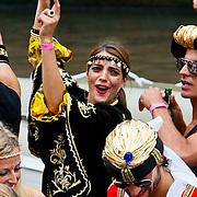 NLD/Amsterdam/20100807 - Boten tijdens de Canal Parade 2010 door de Amsterdamse grachten. De jaarlijkse boottocht sluit traditiegetrouw de Gay Pride af. Thema van de botenparade was dit jaar Celebrate, model Marvy Reider