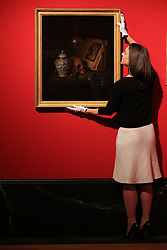 An employee of the Royal Collection Trust adjusts Pieter Gerritsz van Roestraten's A Vanitas, which is on display in the Portrait of the Artist exhibition at the Queen's Gallery, Buckingham Palace, London.