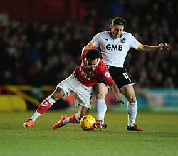 Bristol City's Korey Smith is fouled by Port Vale's Michael Brown  - Photo mandatory by-line: Joe Meredith/JMP - Mobile: 07966 386802 - 10/02/2015 - SPORT - Football - Bristol - Ashton Gate - Bristol City v Port Vale - Sky Bet League One