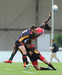 Aderito Esteves attempts to reach the ball as he is tackled high by Fabian Heimpel of Germany - Photo mandatory by-line: Dougie Allward/JMP - Mobile: 07966 386802 - 11/07/2015 - SPORT - Rugby - Exeter - Sandy Park - European Grand Prix 7s