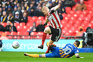 Elliot Whitehouse of Lincoln City (4) and Nathan Thomas of Shrewsbury Town (10) battle for the ball during the EFL Trophy Final match between Lincoln City and Shrewsbury Town at Wembley Stadium, London, England on 8 April 2018. Picture by Stephen Wright.