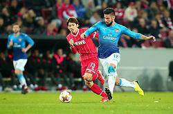 Olivier Giroud of Arsenal takes on Yuya Osako of Cologne - Mandatory by-line: Robbie Stephenson/JMP - 23/11/2017 - FOOTBALL - RheinEnergieSTADION - Cologne,  - Cologne v Arsenal - UEFA Europa League Group H