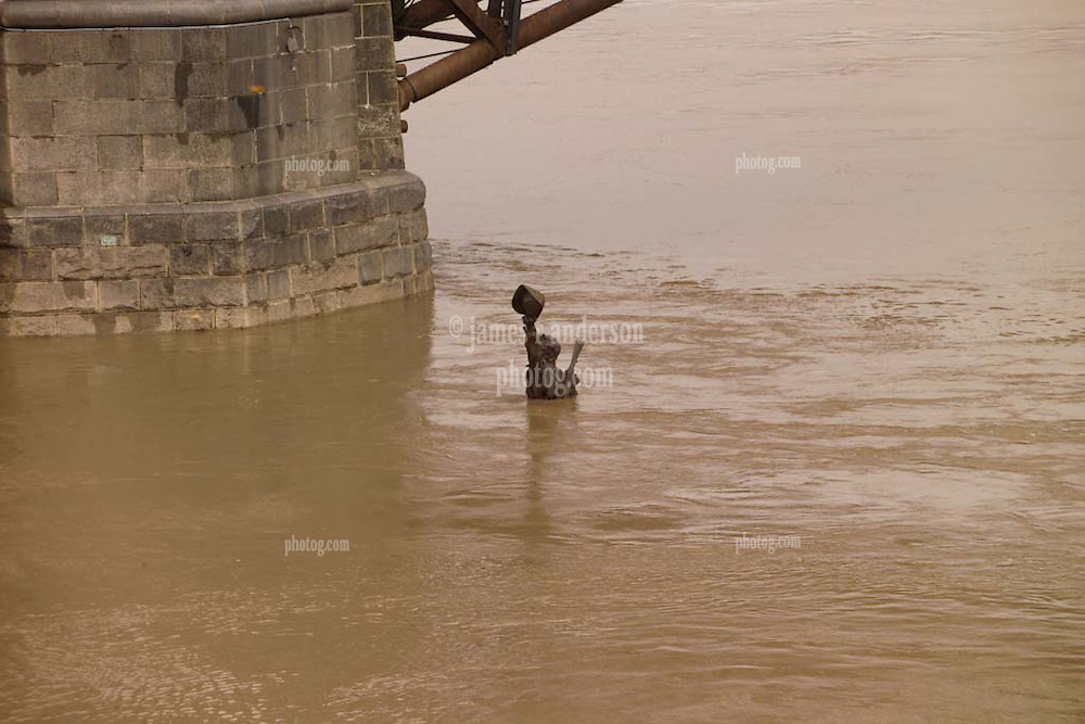 """""""Captains Return"""" Statue Underwater, Saint Louis MO, 100 Year Flood on the Mississippi River 19 March 2008."""