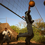 Boys play volleyball in Nagappattinam, on the tsunami-hit southeastern coast of India, as their village goes through reconstruction. .The December 26, 2004 tsunami killed thousands of people along this coast, smashing boats, roads and houses and tearing thousands of families apart. .Picture taken February 2005 in Nagapptinam, Tamil Nadu, India, by Justin Jin