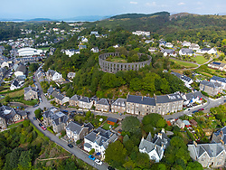 Aerial view from drone of McCaig's Tower and houses in  Oban, Argyll and Bute, Scotland, UK