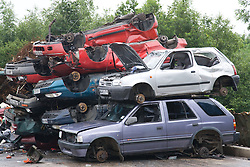 EndofLife vehicles (ELV) piled up waiting to be transported to a depot with shredding facilities,