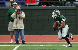 18 October 2014:  Fernando Lozano romps down the south side line returning a kick during an NCAA division 3 football game between the Augustana Vikings and the Illinois Wesleyan Titans in Tucci Stadium on Wilder Field, Bloomington IL