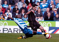 Photo: Leigh Quinnell.<br /> Reading v Portsmouth. The Barclays Premiership. 17/03/2007. Readings Leroy Lita gets a challenge in on Portsmouths Richard Hughes.