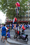 Football fans gather on the outside of a café to watch the match between France and Croatia in the World Cup Final. Paris, France.