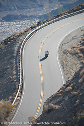 A modern bike heads up the steep mountain pass just out of Palm Desert on the Palms to Pines Scenic Byway in search of old bikes on the last day of the Motorcycle Cannonball Race of the Century. Stage-15 ride from Palm Desert, CA to Carlsbad, CA. USA. Sunday September 25, 2016. Photography ©2016 Michael Lichter.