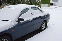 Snow covered car in suburban in Dublin Ireland