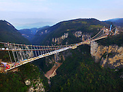 ZHANGJIAJIE, CHINA - DECEMBER 03: (CHINA OUT)<br /> <br /> Grand Canyon Skywalk's Steel Beams Get Completed<br /> <br />  Aerial view of the glass-bottom bridge with steel beams completed at Tianmenshan National Forest Park on December 3, 2015 in Zhangjiajie, Hunan Province of China. World's longest glass-bottom bridge between two cliffs was under construction at Tianmenshan National Forest Park in Zhangjiajie. The skywalk would stretch 430 meters long, 6 meters wide and the biggest vertical drop is 1,430 meters under the path<br /> ©Exclusivepix Media
