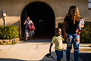 BIRMINGHAM, AL – SEPTEMBER 25, 2019: Antionette Pruitt, 29, picks up her 4-year-old son, Axtyn Taylor from preschool.