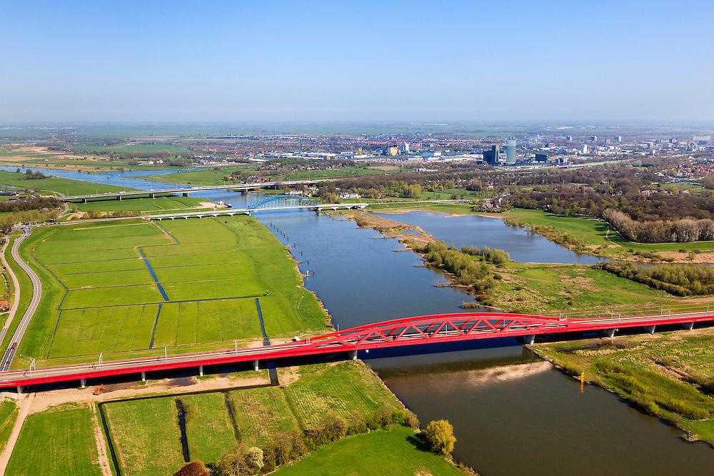 Nederland, Gelderland - Overijssel, Hattem, 01-05-2013; IJsselbrug, spoorbrug bij Hattem voor de Hanzelijn. In de achtergrond de brug voor regionaalautoverkeer en de brug in rijksweg A28 naar Zwolle. <br /> De 'Hanzeboog' is ontworpen door  Quist Wintermans Architecten.<br /> Bridges over the river IJssel near Zwolle. The red railway bridge Hanzeboog (Hanseatic arch) over the IJssel near Zwolle, has been designed by Quist Wintermans Architects.  <br /> luchtfoto (toeslag op standard tarieven);<br /> aerial photo (additional fee required);<br /> copyright foto/photo Siebe Swart