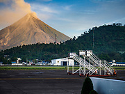 01 FEBRUARY 2018 - LEGAZPI, ALBAY, PHILIPPINES:  The Mayon volcano as seen from the Legazpi Airport. The Mayon volcano started erupting in the middle of January. The airspace around the volcano has been closed off and on for more than week. The airport is about 13 kilometers from the volcano and the ash clouds from Mayon pose a threat to aircraft engines. More than 80,000 people have been evacuated from their homes around the volcano.    PHOTO BY JACK KURTZ
