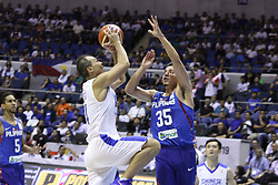 November 27, 2017 - Quezon City, NCR, Philippines - Wen-Chen Tsai (14) of Chinese Taipei tries to shoot the ball over Matthew Wright (35) of the Philippines during their FIBA World Cup Qualifying Game..Gilas Pilipinas defeated the visiting Chinese Taipei team 90-83 to complete a sweep of their first two assignments in the FIBA 2019 World Cup qualifiers. (Credit Image: © Dennis Jerome S. Acosta/Pacific Press via ZUMA Wire)